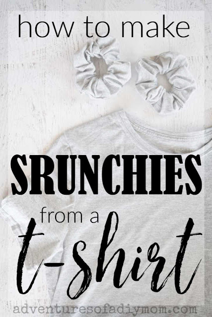 "a grey t-shirt and two scrunchies laid out on a painted wood background. The words ""how to make scrunchies from a t-shirt"" overlaid on top."