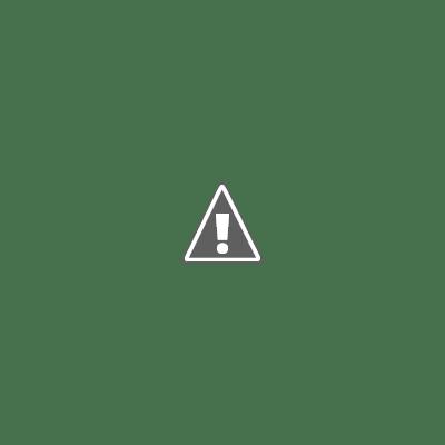 Binnenkant van een kantoorunit met wasbak en keukenblad