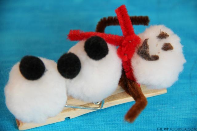 This snowman craft helps kids work on fine motor skills.