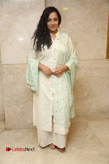 Actress Nithya Menen Latest Pictures in White Dress at 100 Days of Love Movie Audio Launch  0118.JPG