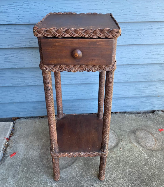 Photo of a small vintage plant stand with drawer