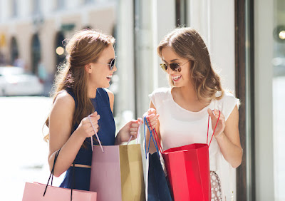 Photo of girlfriends shopping and comparing purchases
