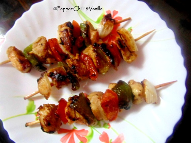 chicken with capscicum and onion on wooden skewers