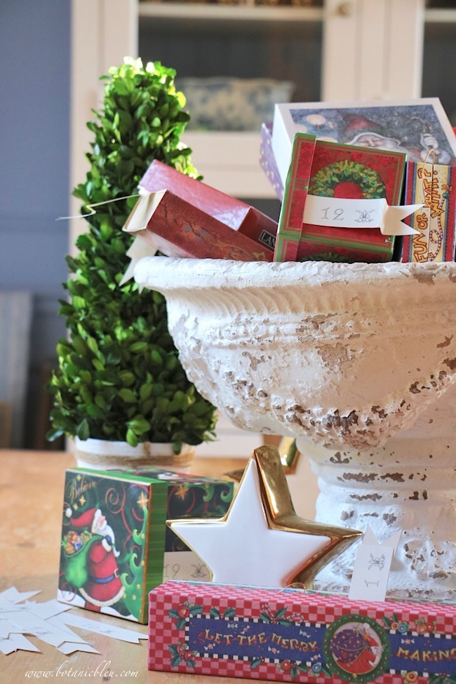 Advent calendar Christmas boxes in a French Country urn