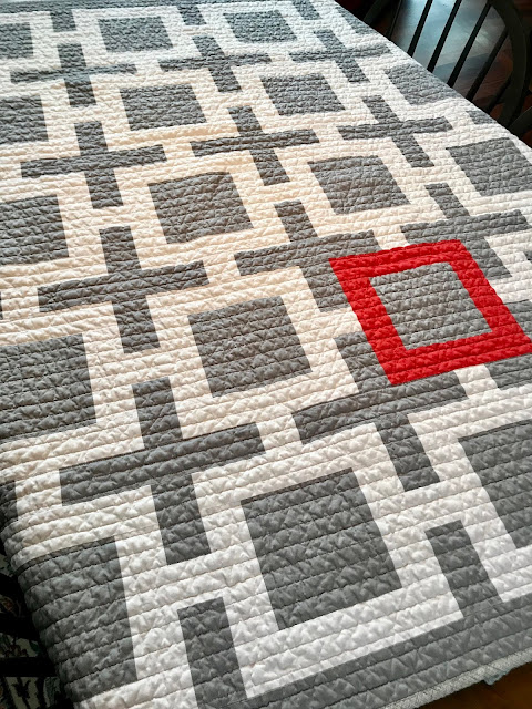 midcentury modern quilt white gray with a coral accent