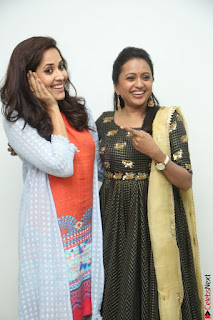 Actress Suma in Black Salwar Suit and Anusuya in orange Dress at winner movie press meet part 1 February 2017 (15).JPG