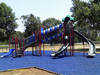 eco-friendly, safe, recycled rubber mulch playground surface in blue