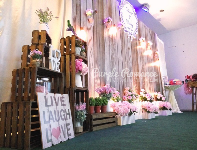 photo booth backdrop, rack, wooden crates, rustic, flowers, floral, garden, live, laugh love, logo, event styling, annual dinner, instant print service, planning, props, photo taking, green carpet, weddings
