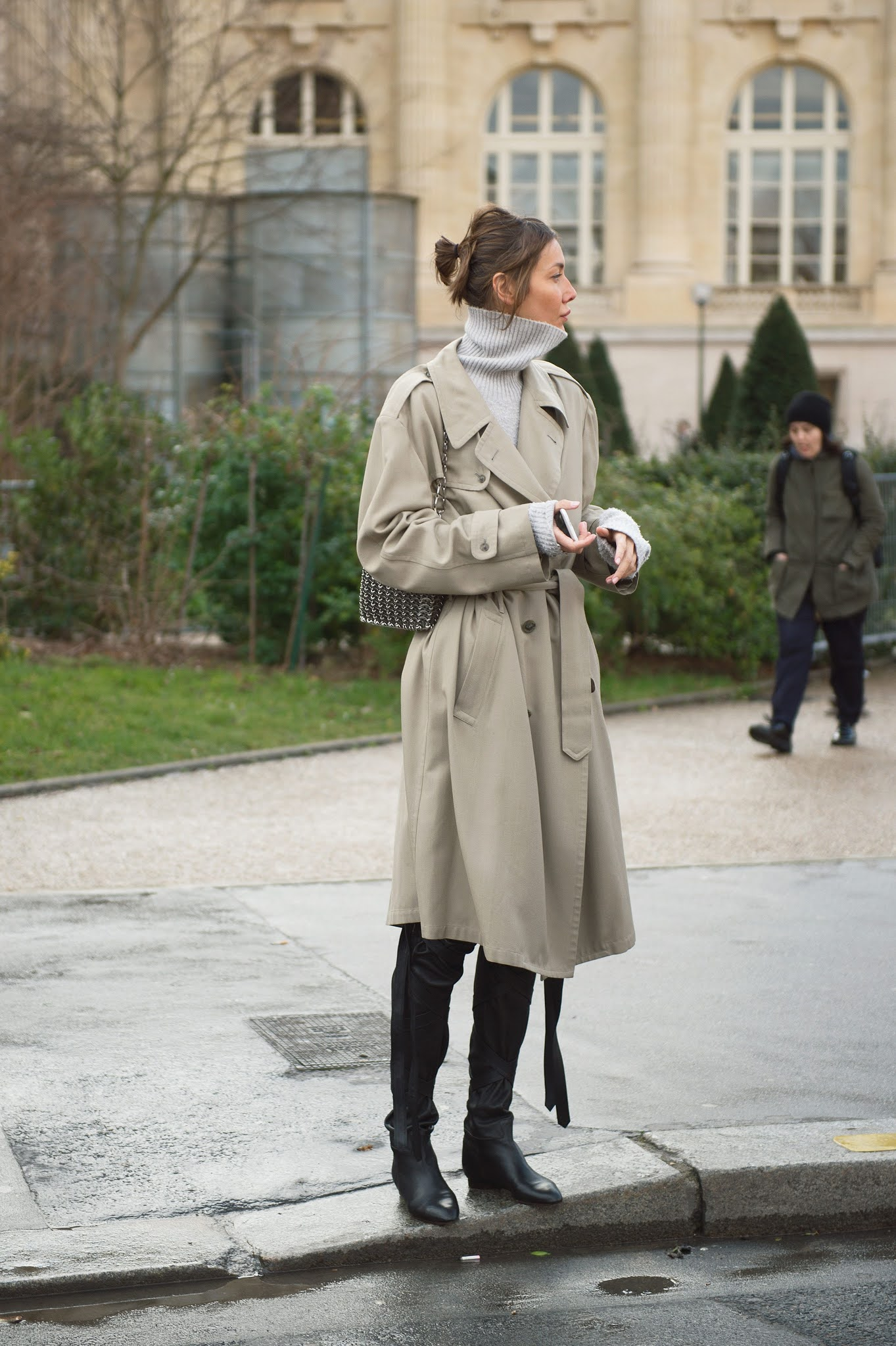This Incredibly Stylish Fall Outfit Is Super Easy to Recreate —Juli Pelipas street style outfit with a trench coat, gray turtleneck sweater, metal bag, and black over-the-knee boots