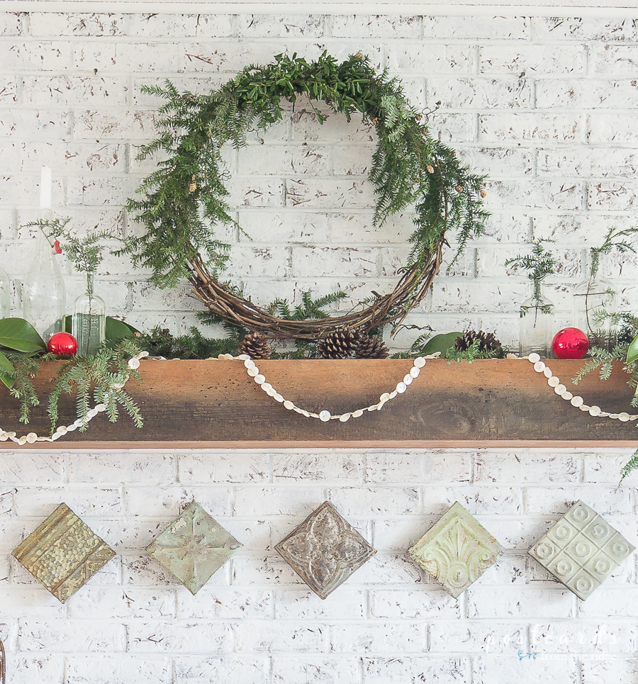 fireplace mantel with grapevine wreath
