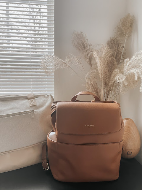 Weekender bag, brown diaper bag with pampas and diffuser in the background