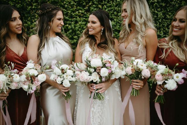 bride with smiling bridesmaids