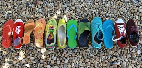 multi-colored shoes on rocks