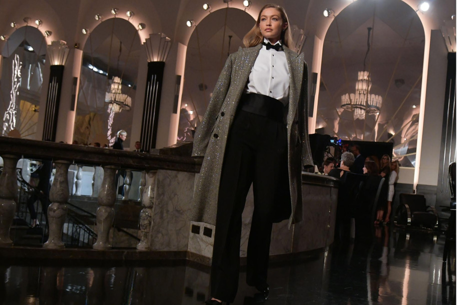 Gigi was styled in a white button-up shirt with a black bow-tie and trousers, adding patent shoes and an oversized blazer