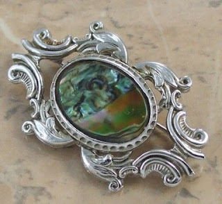 Silver ornate abalone brooch by Exquisite