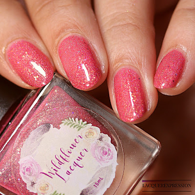 Swatches of a pink nail polish with holo and gold shimmer and microglitter by Wildflower Lacquer for the Le Petite Indies Spring It On! collaboration box