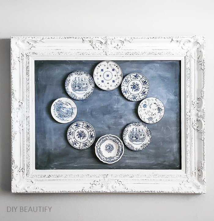 plate wreath hung on chalkboard