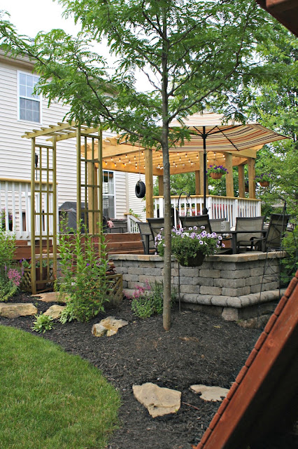 Pergola, deck and paver patio with landscaping