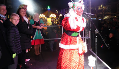 Pantomime star Annie Fanny entertaining the crowd at the Brigg Christmas lights switch-on 2018 in the Market Place - picture on Nigel Fisher's Brigg Blog.