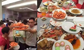 Chinese tourists shovel food on their plates at buffet in Thailand