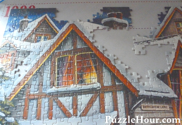 Jigsaw puzzle traditional house top edge in the works not completed