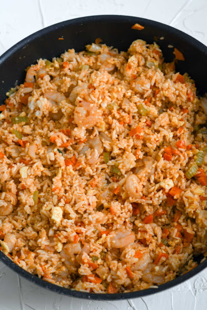 skillet full of shrimp fried rice ready to serve