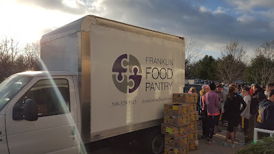 Food Pantry truck loading with the 20 nonperishables for the Franklin Turkey Trot