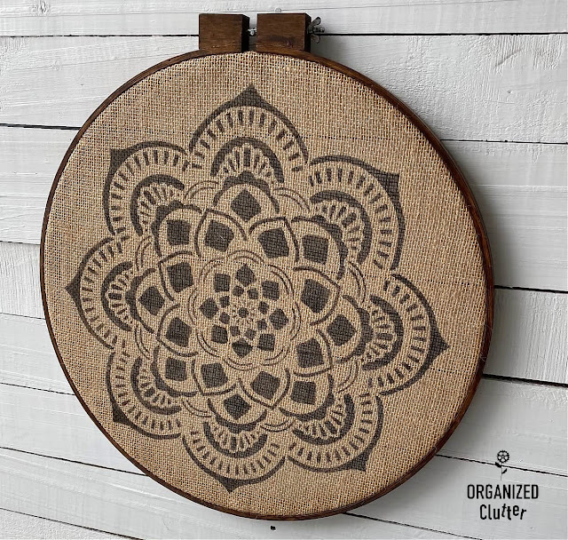 Photo of stenciled mandala on burlap framed with quilting hoop