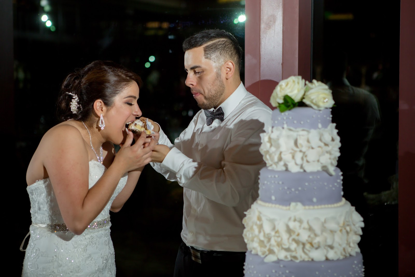 Bride and Groom take first bites of their Wedding Cake