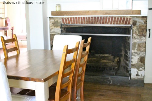 primitive farmhouse dining room stone fireplace