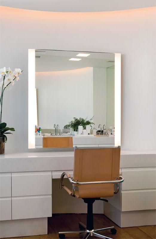 Dressing table with lighting on the side of the mirror