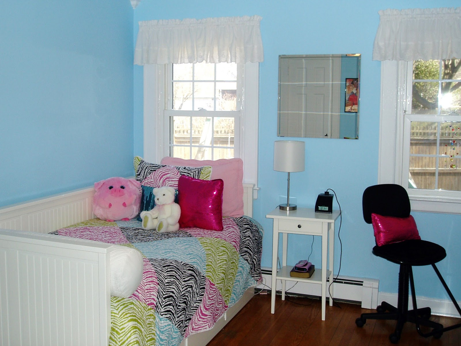 Blue bedroom with rainbow zebra quilt