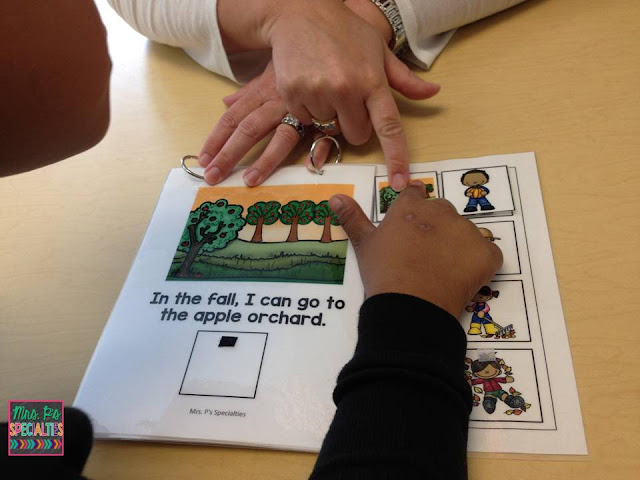 photo of student pointing to the matching picture in an interactive book