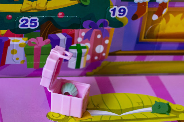 The surprise behind door 25 of the Polly Pocket calendar is a present with skirts inside