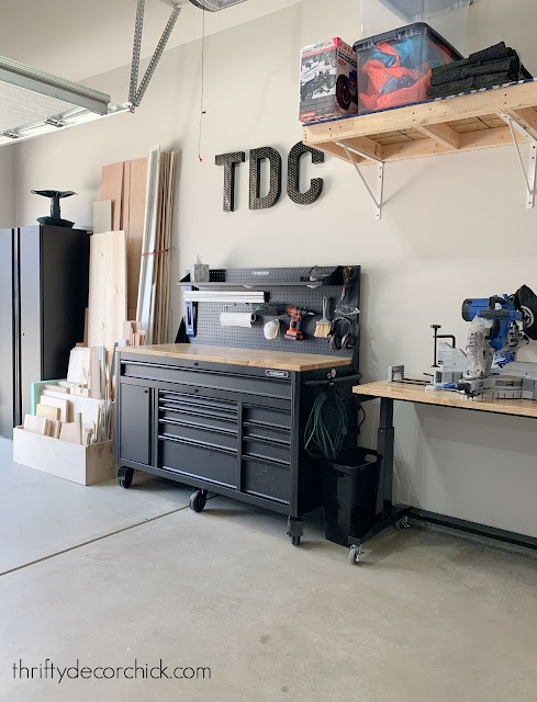 organized garage with wood and tool storage