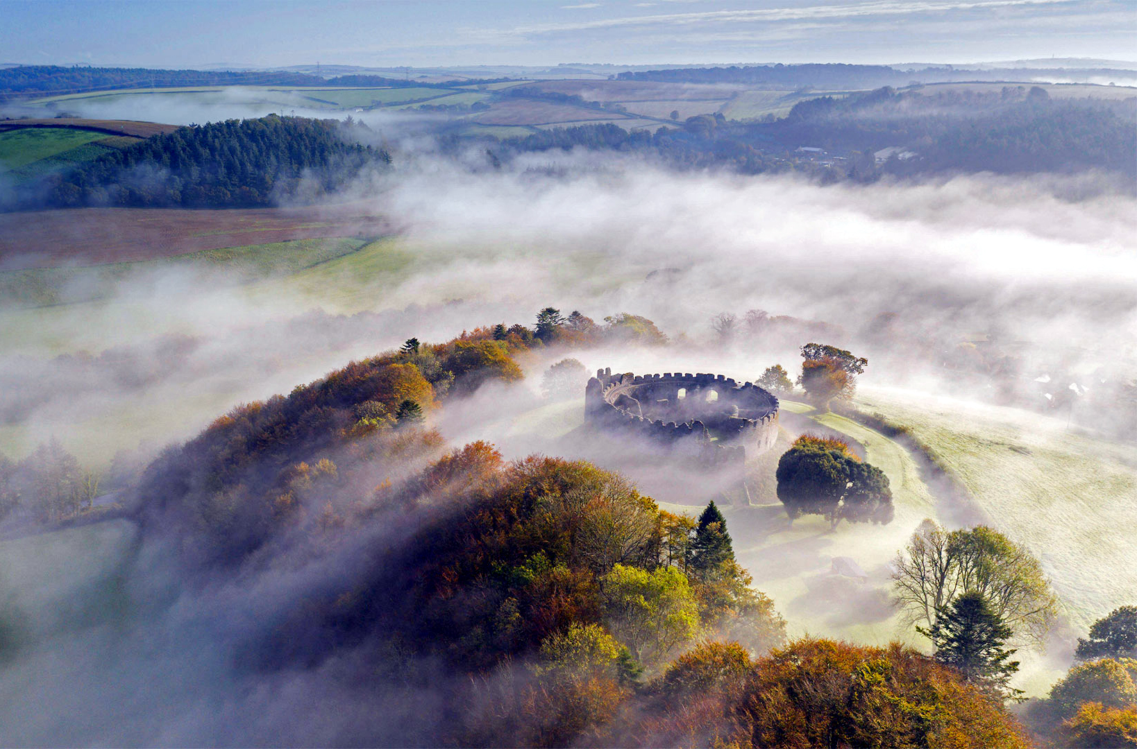 Autumn mist above Restormel Castle in Cornwall, England