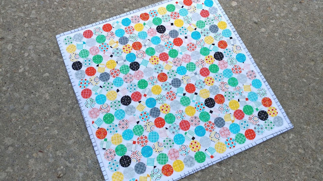 Pi Day mini quilt with raw edge circles
