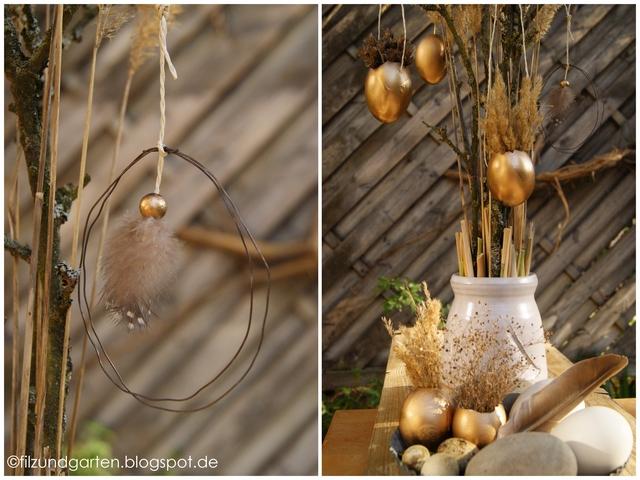 Osterdeko mit goldenen Eiern und Anhängern aus Perlhuhnfedern