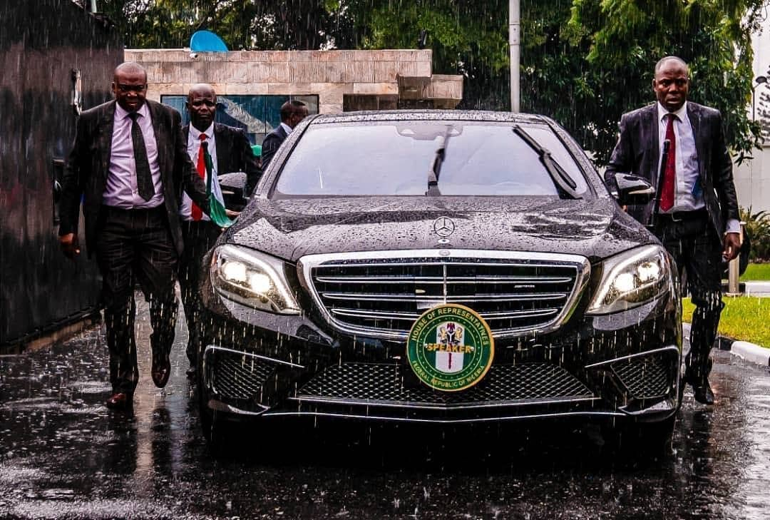 Caption This Photo of Femi Gbajabiamila's Security Aides In Rain