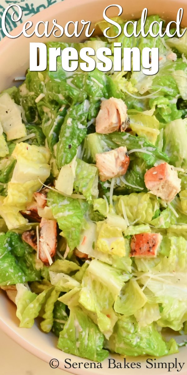 Caesar Salad with Caesar Dressing and Chicken in a bowl with white letters at the top saying Caesar Salad Dressing.