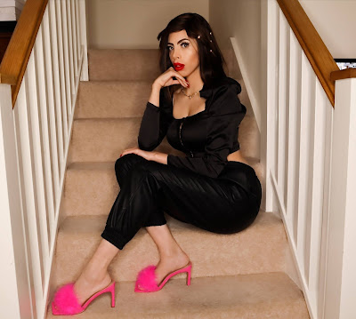The Femme Luxe Black PU Faux Leather High Waisted Cuffed Joggers in model Amina