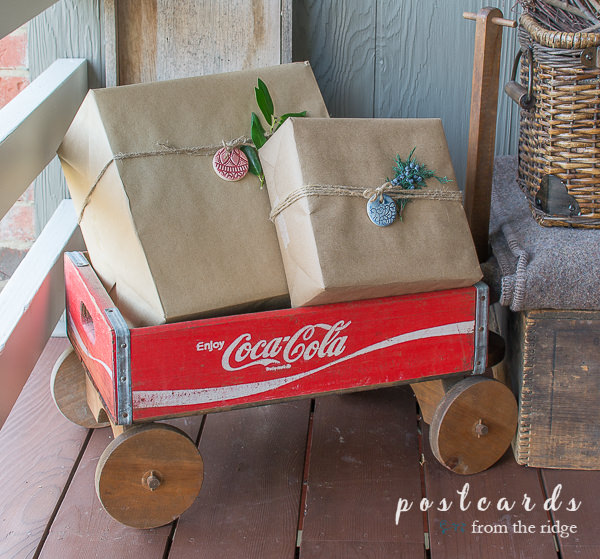 vintage coca cola crate wagon with brown paper packages tied up with string