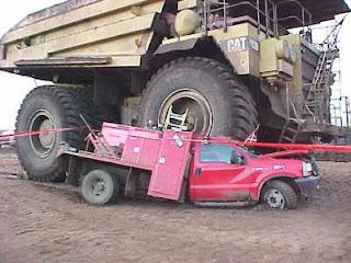 giat dump truck crushes car
