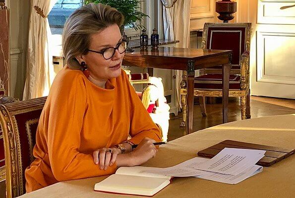 Queen Mathilde is honorary president of Unicef Belgium. Queen Mathilde wore a new orange silk blouse top from Natan, and orange earrings