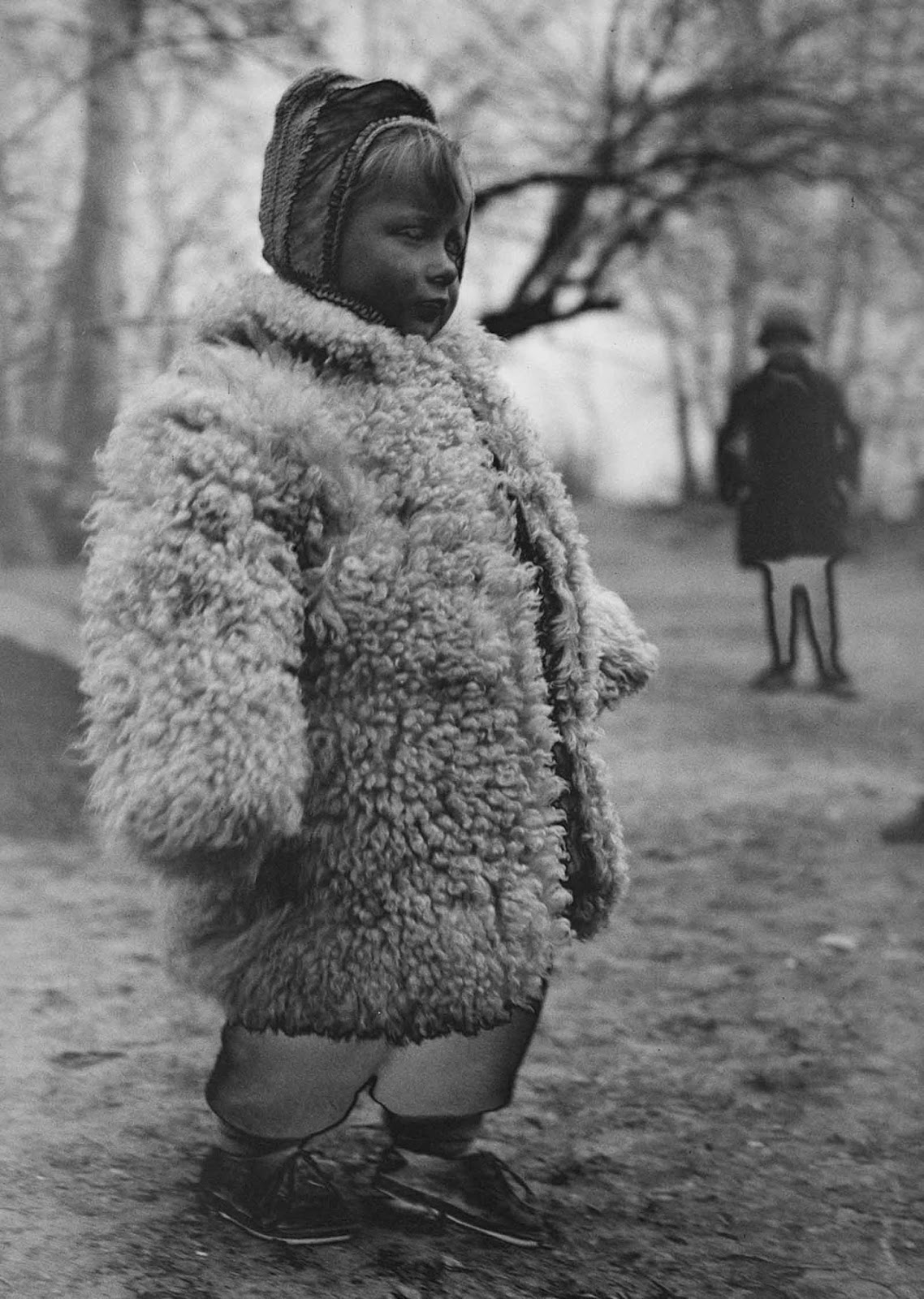 A Polish girl wears a heavy sheepskin coat at a refugee camp.