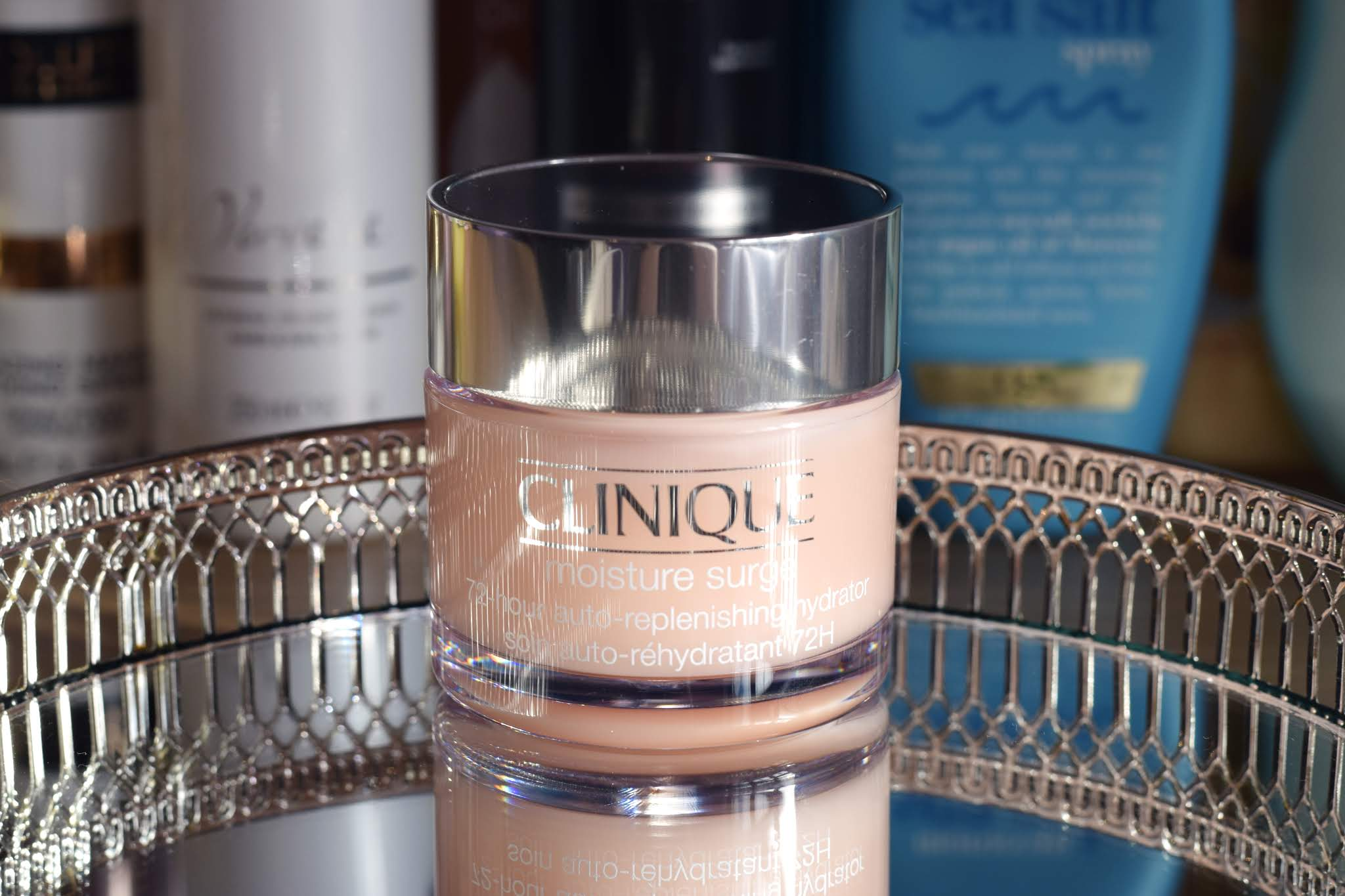 a pot of Clinique Moisture Surge standing on a mirrored tray