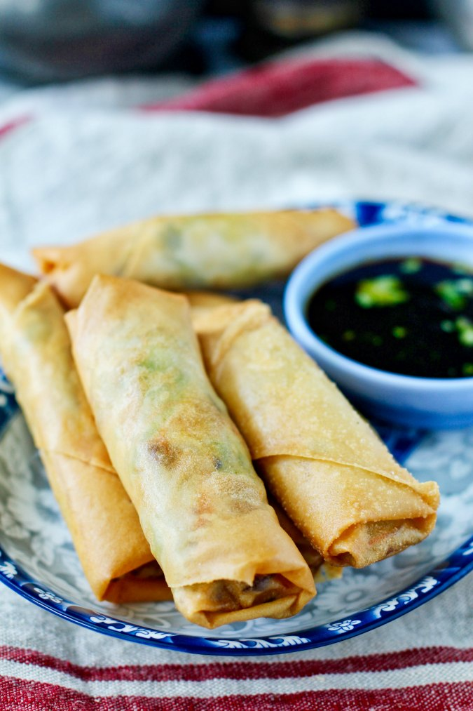 Deep fried pork and vegetable spring rolls