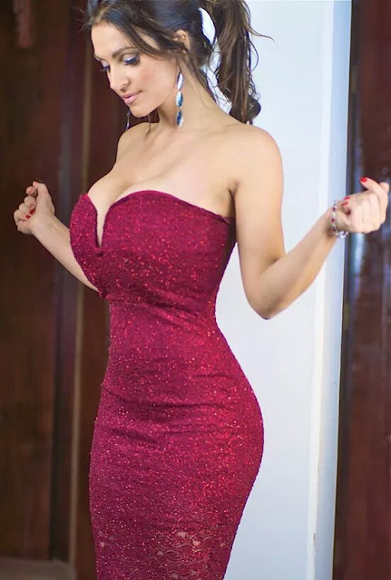 Denise Milani in maroon dress
