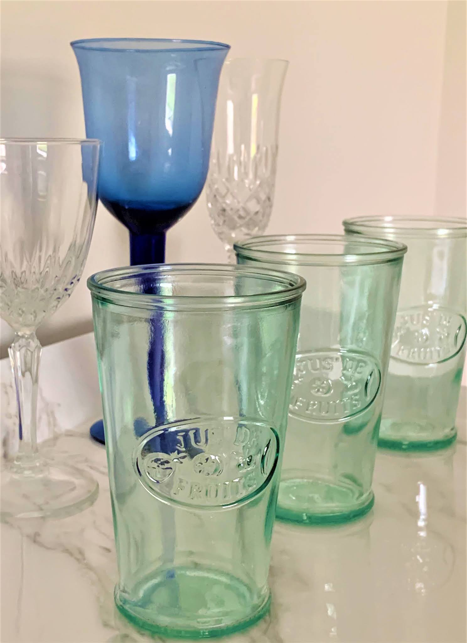 An assortment of drink glasses for drink station