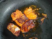 Crisp golden charred fish tikka on tawa or pan